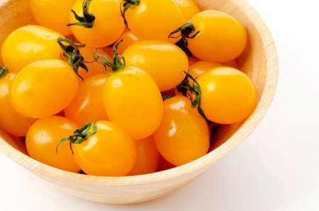 Fresh cherry tomatoes aiko in Wooden bowl on white background