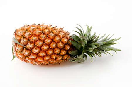Fresh ripe pineapple fruit on white background Фото со стока