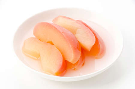 Apple compote on a white plate 免版税图像