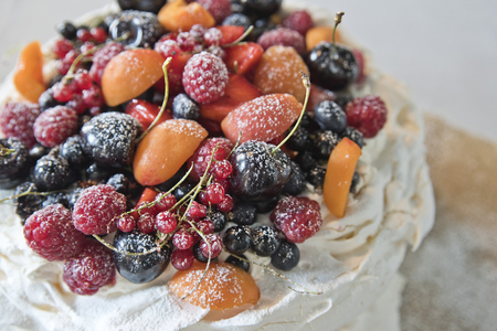 Cake meringues with fruits and berries. Currants, cherries, raspberries and apricots