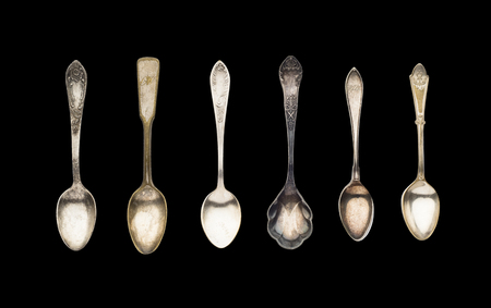 Vintage Tea Spoons isolated on a black background Stock Photo