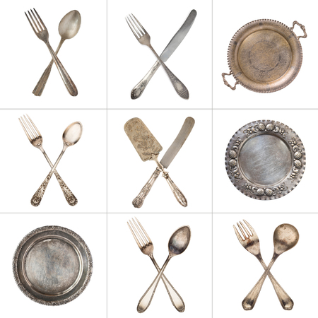 A set of crossed vintage spoons, forks, knives and silver old plates. Isolated on white. Tic Tac Toe. Stok Fotoğraf