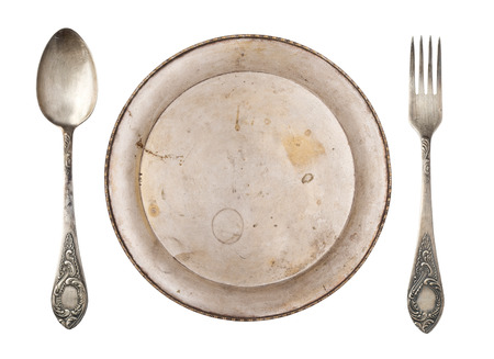 Vintage beautiful plate, spoon and fork isolated on white background. 免版税图像