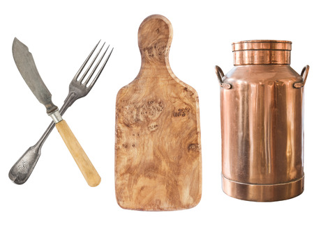 A set of antiques, fork, knife, board and milk can Фото со стока