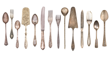 Top view of beautiful vintage silver knife, spoon and fork  isolated on white background. Silverware.