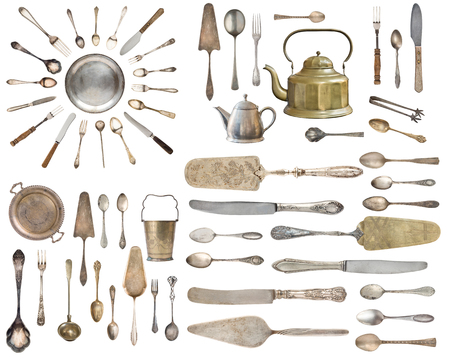 Vintage Silverware, antique spoons, forks, knives, ladle, cake shovels isolated on isolated white background. Antique silverware. Retro.