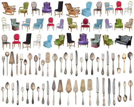 Vintage armchairs and Silverware, antique spoons, forks, knives, ladle, cake shovels isolated on isolated white background. Antique silverware. Retro 写真素材