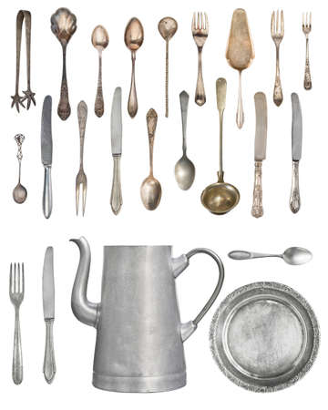 A large set of antiques isolated on a white background. Old spoon, fork, knife, kettle, steamer