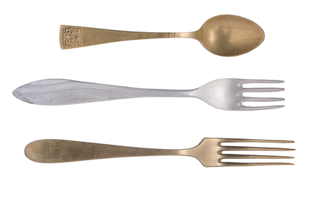 Vintage tea spoon and forks isolated on a white background. Retro silverware.