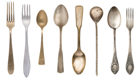 Top view of forks and spoons. Vintage cutlery. Isolated on white background.