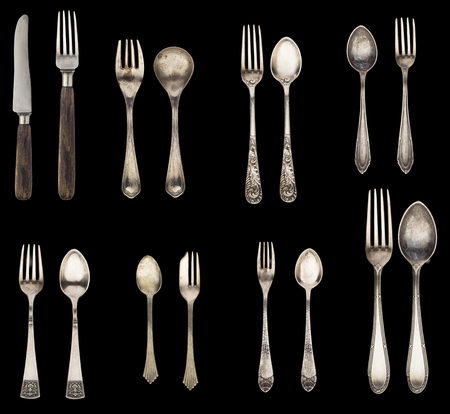 Vintage spoon, fork and knife isolated on a black background. Retro silverware. 写真素材