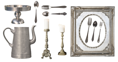 vintage dishes. Old spoon, fork, knife, kettle, frame isolated on white background Imagens