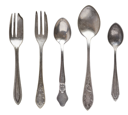 Vintage tea spoons and forks isolated on a white background. Retro silverware.
