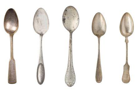 Vintage metal antique tea spoons isolated on a white background. Retro silverware. Stockfoto