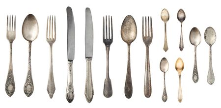 Beautiful old vintage forks. spoons and knife isolated on white background. Top view. Retro silverware.