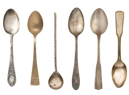 Vintage old tea spoons isolated on white background