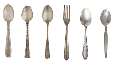 Top view of beautiful vintage silver spoons and forks  isolated on white background. Silverware.