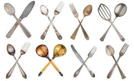 Set crossed vintage spoon and fork isolated on old vintage background. Rustic style. Stockfoto