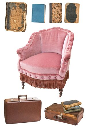 Vintage pink armchair, books, suitcases isolated on white background. Reklamní fotografie