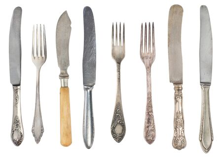 Beautiful old vintage fork and knife isolated on white background. Top view. Retro silverware. Stockfoto