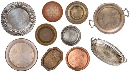 Antique metal painted plates isolated on white background. Retro style. Vintage. Stockfoto