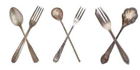 3 set crossed vintage spoon and fork isolated on old vintage background. Rustic style. Imagens