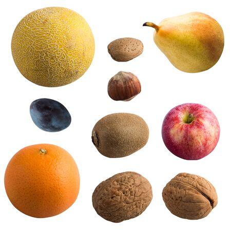 Fruit isolated on a white background. Melon; pear; apple and orange, Kiwi; plum; walnut; almonds; hazelnuts
