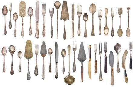 Top view of beautiful vintage silver knifes, spoons and forks  isolated on white background. Silverware.  Stockfoto