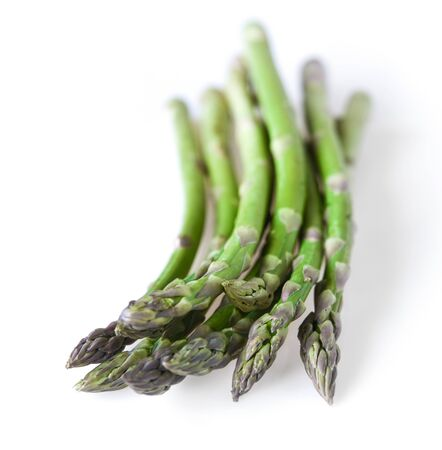 Green fresh asparagus on a white background. Copy space.  Banco de Imagens