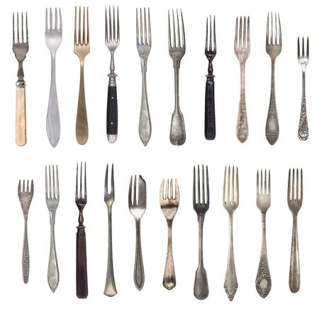 Beautiful old vintage forks isolated on white background. Top view. Retro silverware.