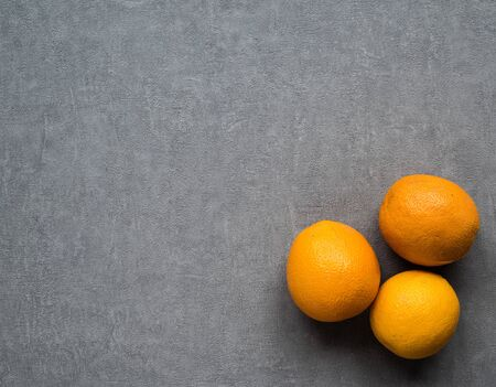 Background for the menu. Brown shabby background with oranges. Copy space.