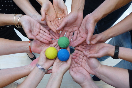teambuilding: Teambuilding hands with ball Teamwork Team game Team play