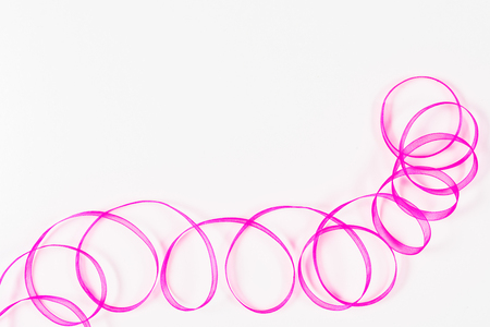 taping: Pink fancy tape on white background Stock Photo