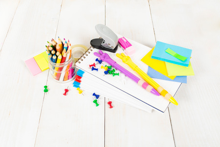 Back to school concept - many school stationary in the center of the white wooden table Stock Photo