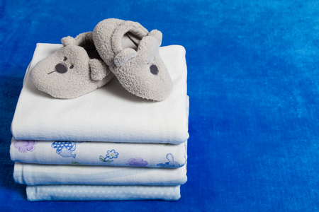 shroud: Set of the diapers and booties with copy space