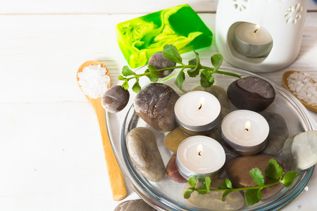 Composition with some ingredients for spa relaxation on the white wooden background Stock Photo