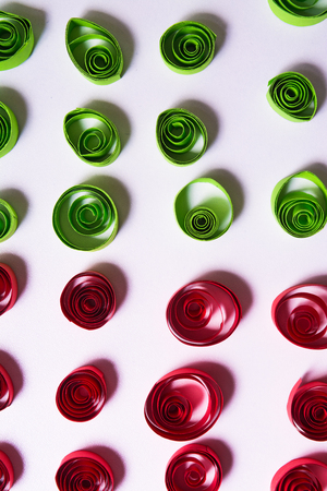 Quilling art. Color paper curls on the white background with top view Stock Photo