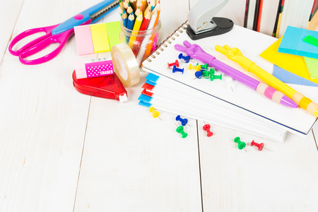 School stationary on the white wooden table with copy space
