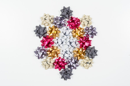 beige: Colored bows on white background, top view