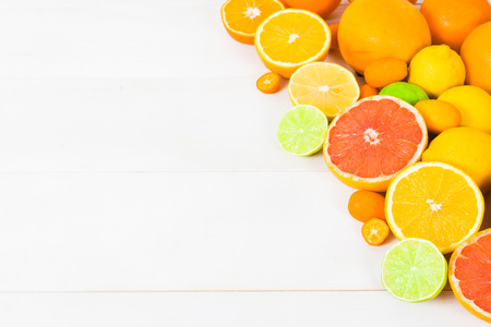 nectar: Different citrus on white wooden table with copy space Stock Photo
