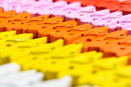 Background of colorful wooden small pegs lines with selective focus Stock Photo