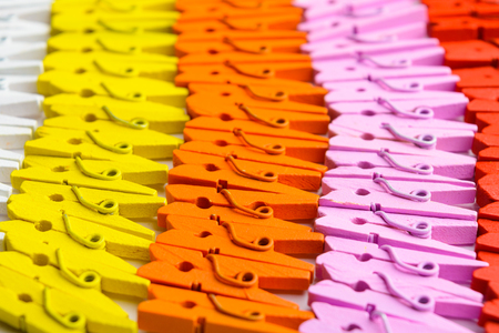Colorful wooden small pegs lines with selective focus Stock Photo