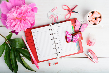 Woman organization plan with notebook, hot chocolate and flower Stock Photo