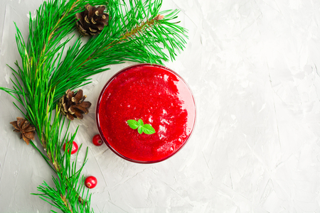 Thanksgiving day cranberry sauce over grey background with copy space, overhead shot Stock Photo