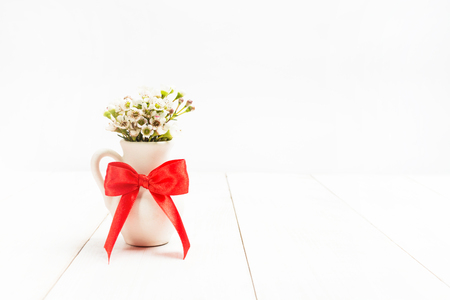 Flowers In Small Vase With Red Bow Valentine Card Concept On