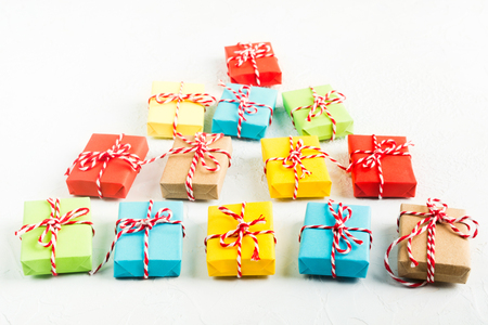 Christmas tree of colorful gift boxes on white background, selective focus Stock Photo