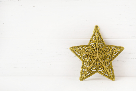 Christmas star on white wooden background with copy space, New Year decoration