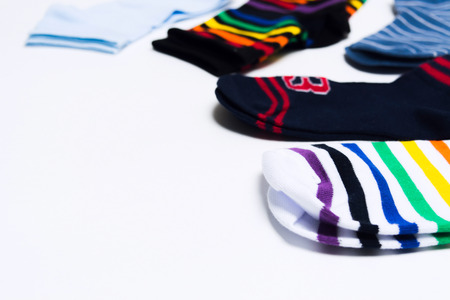 Colorful textile socks on white background for legs with copy space. Shopping concept for store. Selective focus. Various type of socks Stock Photo