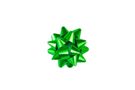 Green paper holiday bow over white isolated background. Single object. Mockup. Top view. Decoration for present