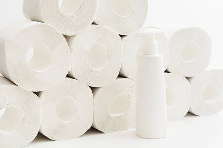 Many toilet paper rolls, hygiene liquid antiseptic gel or soap. Two items for online shopping concept when quarantine. Covid-19, coronavirus. Items that byeing in panic